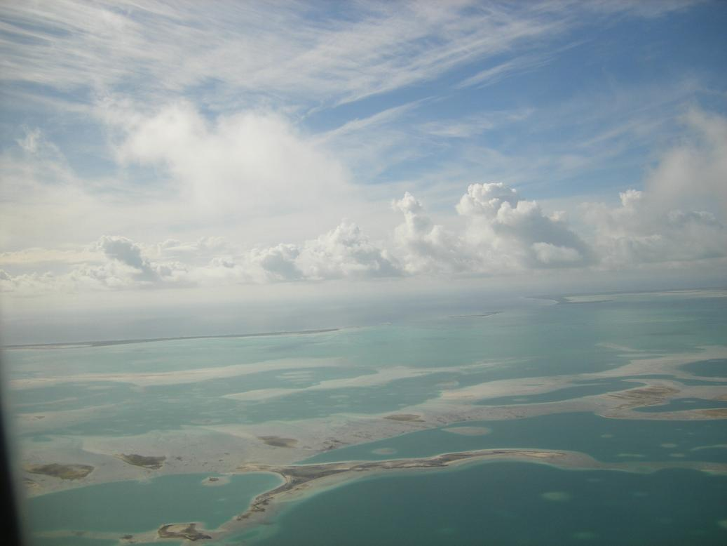 Flying over the largest coral atoll in the world and looking towards the lagoon opening on the wouthwestern side.